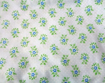 1 yard light blue cotton with dark blue flowers and white dots