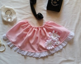 Pretty in pink skirt with white lace ruffles and white flower appliqués.