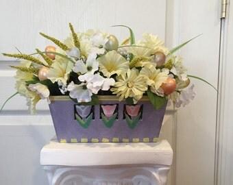Easter floral arrangement in wooden plantet