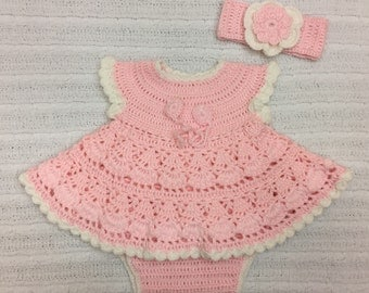 Crochet newborn dress set with matching headband and diaper cover . Soft pink and white coming home outfit.