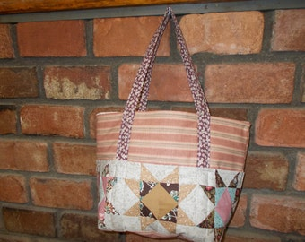 Tote bag with 6 quilted exterior pockets only 1 available