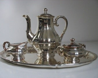 Silver on Porcelain Teapot, Suger & Cream Cups and Tray