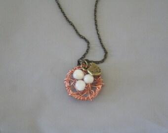 Bronze bird nest necklace
