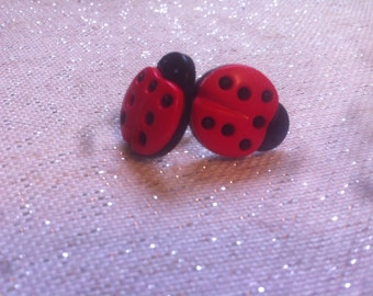 Lady's in the house bug earrings