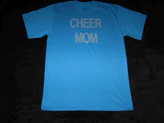 Custom Turquoise Cheer Shirt That has CHEER MOM on the Front in Silver Rhinestones, it is a Adult Medium
