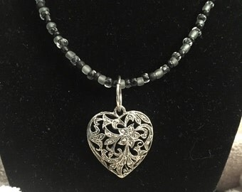 Silver heart with black beads