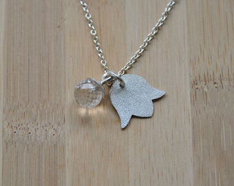 Silver necklace and pendant with flower and white quartz