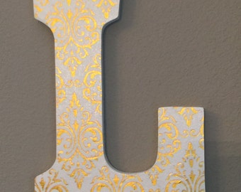 Gold and white initial letter wall decor