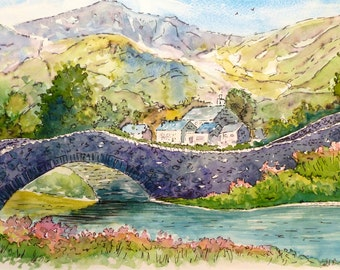 Watercolour painting of an old stone bridge in Wales
