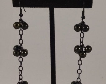 Iridescent Black and Green Dangles by Sparrow