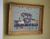 Quaint Fisherman's Wharf Crewel Needlework.  Ornate plaster frame.