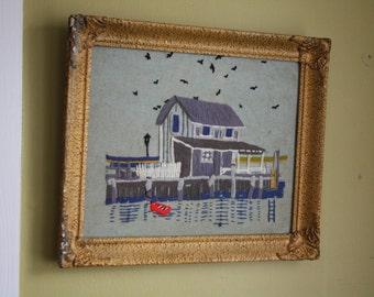 Quaint Fisherman's Wharf Crewel Needlework.  Ornate plaster frame.