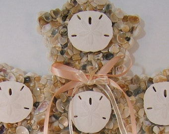 "Beach Decor, Large Seashell and Sand Dollar Wall Cross with Peach and beige colored Ribbon Bows, 16-1/2"" tall x 12-1/4"" wide x 1"" thick"