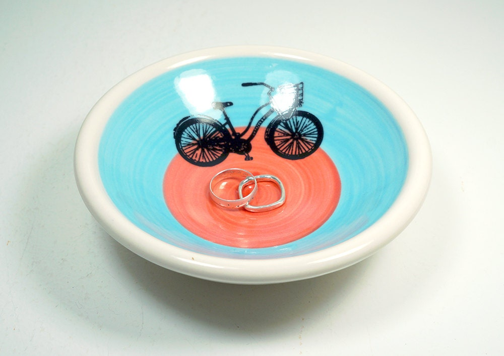 "small dish, with with what we like to call the ""speedy delivery"" bike on a color block of sky blue & red-orange, made to order."