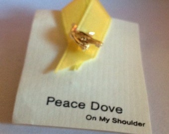Peace Dove on my shoulder clutch lapel pin goldtone dove on yellow ribbon.