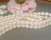 "Bastet's Beads-  7.5"" Strand Snowy White Baroque Potato Pearl- 7x9mm"