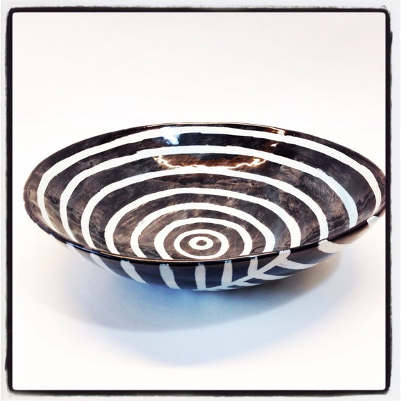 Disc ceramic bowl with black and white pattern perfect for