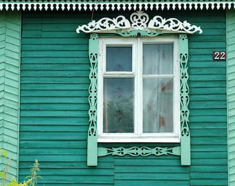 Decorative Russian Window Photography. Woodwork. Dacha, cabin. Ancient architecture. Blue green.  Russia.