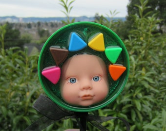 Green Flower Pop Baby - upcycled bottle cap doll stick