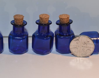 5 blue glass bottle vials  with cork with eye screws cube shape