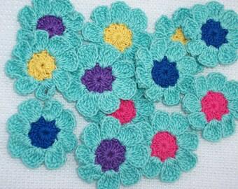12  crochet applique flowers with aqua petals   -- 1916