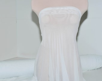 """Power mesh stretch fabric, semi sheer, 4 ways stretch.. White  . 58 """" wide.. dance, pageant, formal, costume,"""