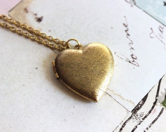 heart. locket necklace. gold ox with etched lines