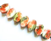 SUNSET CORAL GARDEN    7 ivory, silver, and sunset coral floral zulus    A Beaded Gift