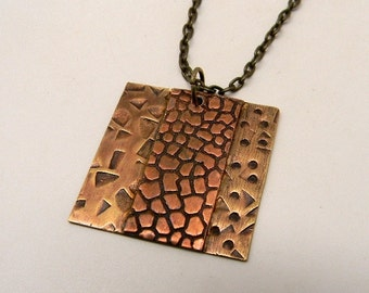Mixed metal steampunk jewelry necklace pendant.