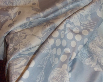 Fabric white and grey flower stripe and polkadot print.