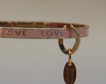 Pink enamel charm bangle with LOVE inscription in gold, by Stjern Design