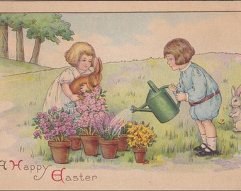 Easter postcard, vintage postcard, Boy watering plants and Girl holding Easter bunny rabbit