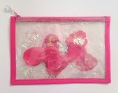 ENCHANTED ROSE pink rose petal iridescent glitter clear vinyl clutch zippered pouch