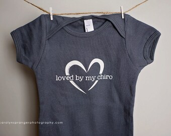 Loved by my Chiro one-piece or tee (Pick Your Color & Size)
