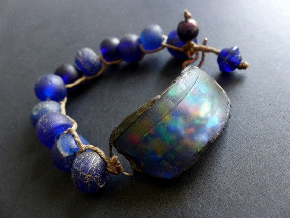 Weltgeist. Chunky assemblage bracelet with iridescent beach glass and chunky antique African glass in bright cobalt blue.