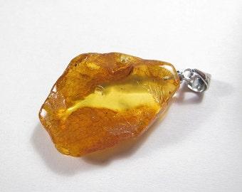 Pendant, handmade of a Baltic amber. EK163