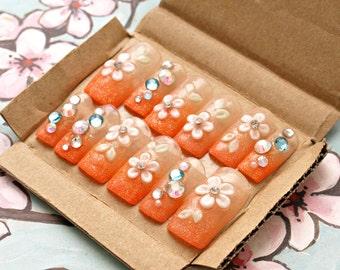 Summer nails, gel nails, orange, glittery, acrylic nails, gyaru, 3D nails, flower emboss, nail gem, glam nail, false nails, tropical, beach