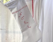 Scandinavian style, red embroidery on white Christmas ruffled stocking - Noel