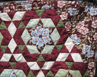 Kaleidoscope quilted wall hanging small lap wall art wheel chair quilt burgundy pink and green