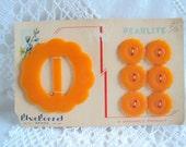 Flower Buckle and Buttons set 1920s  Tangerine Orange on original card