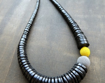 Sale 50 %: Licorice black wooden discs combined with a grey and lemon yellow crochet detail for this necklace