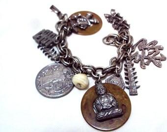 Oriental Charm Bracelet, Buddha,Temples,Warrior, Kanji, 2 Bakelite Circles