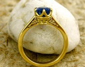 Blue Sapphire Solitaire Engagement Ring in 18K Yellow Gold with Scroll Detail on the Basket Size 6