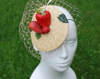 Strawberry and fork fascinator with veil