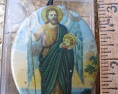 John The Baptist With Wings Holding His Own Head On Old Celluloid Oval Pendant