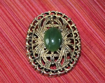 Vintage Peri gold metal brooch with green stone, REDUCED