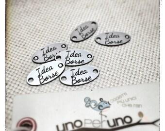 50 custom plastic tags (looks like aluminum), laser cut and engraved