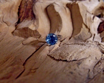 Sterling Silver Ring with Blue Topaz RF720