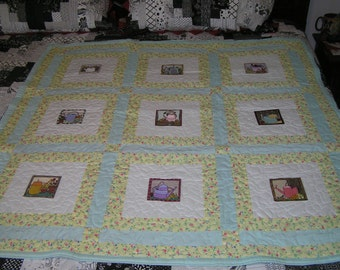 Handmade   lap quilt featuring embroidered garden things