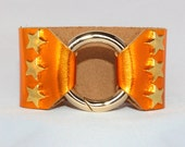 Gold Star Studded Ring Clasp Cuff on Orange Metallic Leather support your favorite team by Rockin its Colors